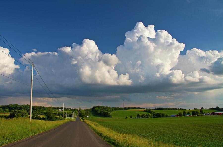 Puffysummer Clouds And Country Farm Road Photograph by Matt Champlin