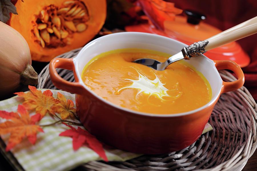 Pumpkin Soup In Skew With Creme Fraiche Photograph by Moncherie