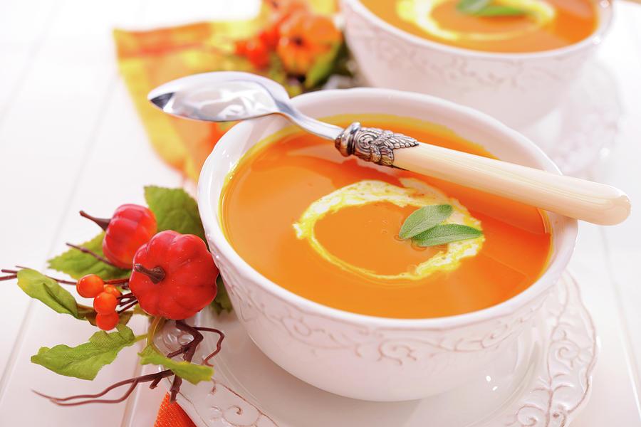 Pumpkin Soup With Creme Fraiche Photograph by Moncherie