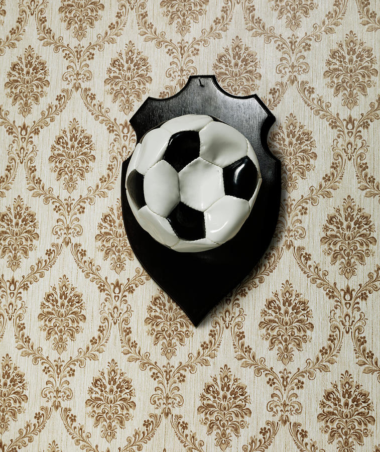 Punctured Football Hanging As A Trophy Photograph by Henrik Sorensen
