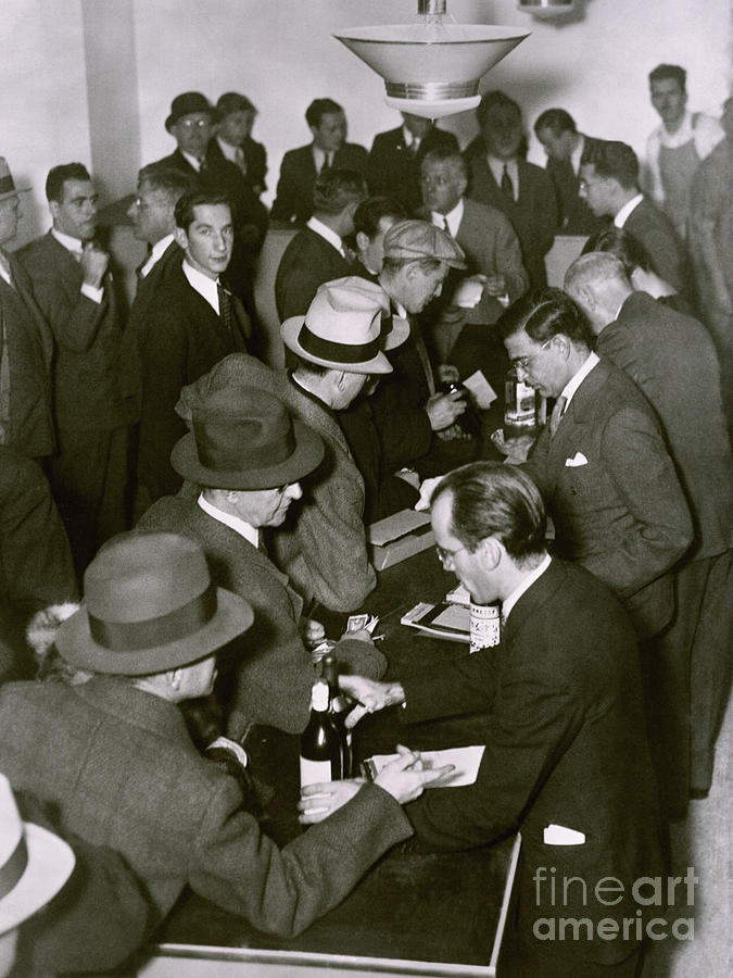 Purchasing Alcohol In A Speakeasy Photograph by Bettmann