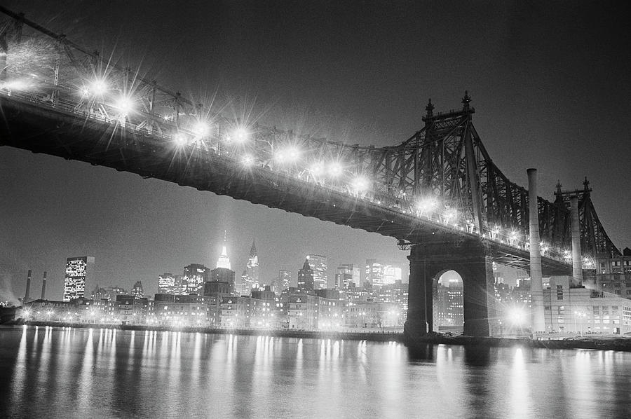 Queensboro Bridge And Manhattan At Night Photograph by Bettmann