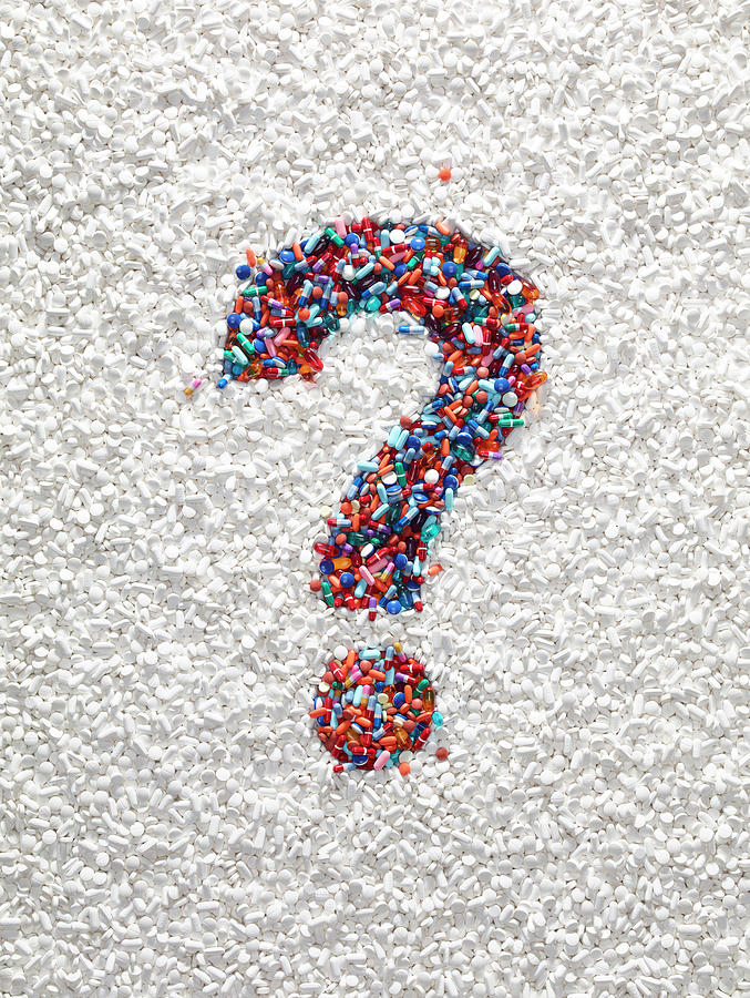 Question Mark Pills Photograph by Dwight Eschliman