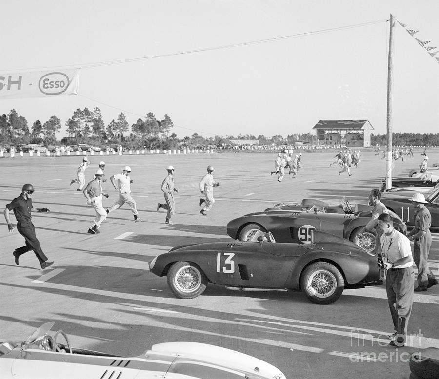 Racecar Drivers Running To Cars Photograph by Bettmann