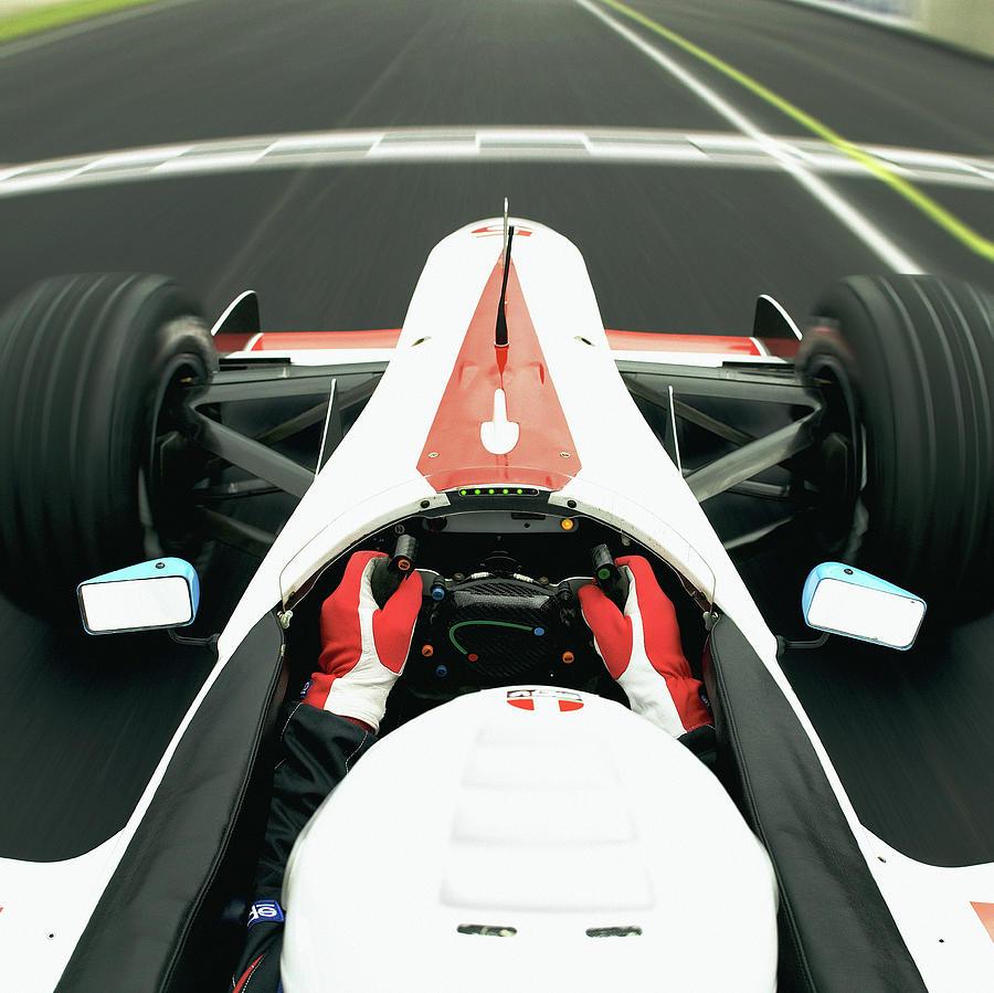 Racing Driver Approaching Finishing Photograph by Alan Thornton