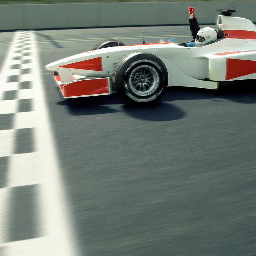 Racing Driver Crossing Finishing Line Photograph by Alan Thornton