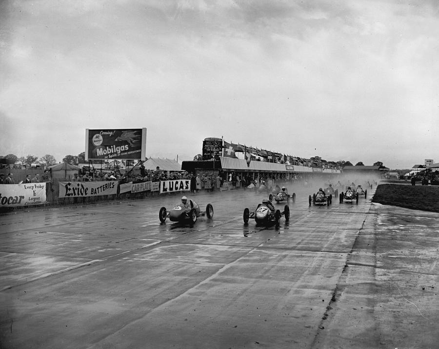 Racing In The Rain Photograph by Central Press
