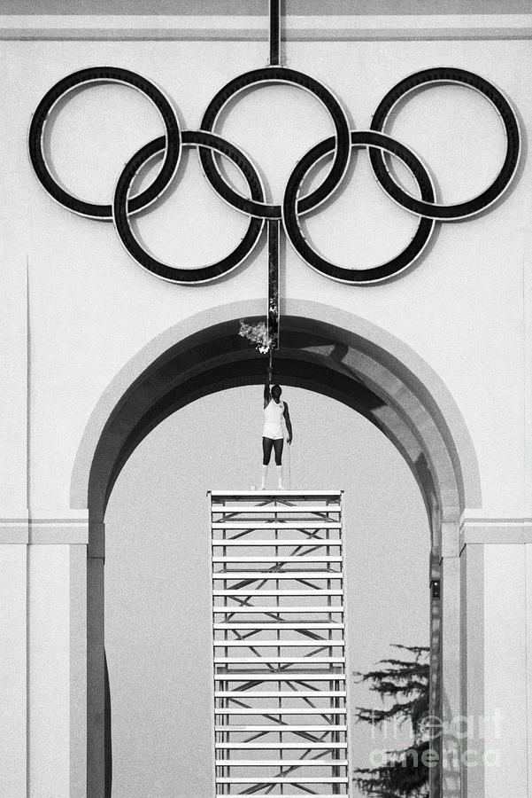 Rafer Johnson Lighting The Olympic Flame Photograph by Bettmann