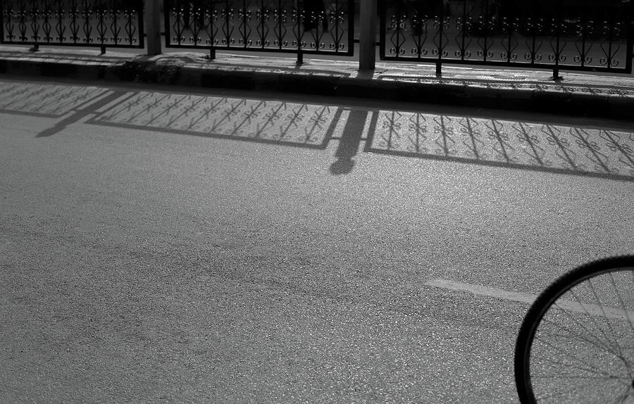 Railing Shadow Vs Bicycle Tyre by Prakash Ghai