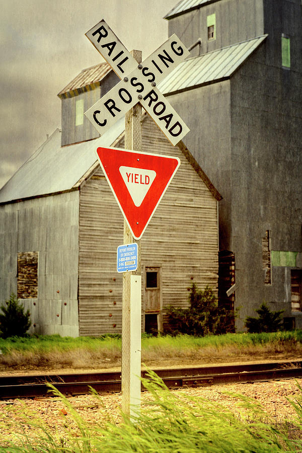 Joan Carroll Photograph - Railroad Crossing Cottonwood South Dakota by Joan Carroll