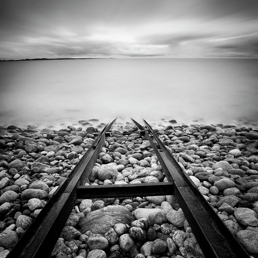 Railroad Tracks Into Water Photograph by Peter Levi