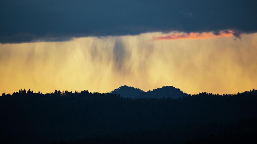 Rain at sunset over the Ljubljana hills by Ian Middleton