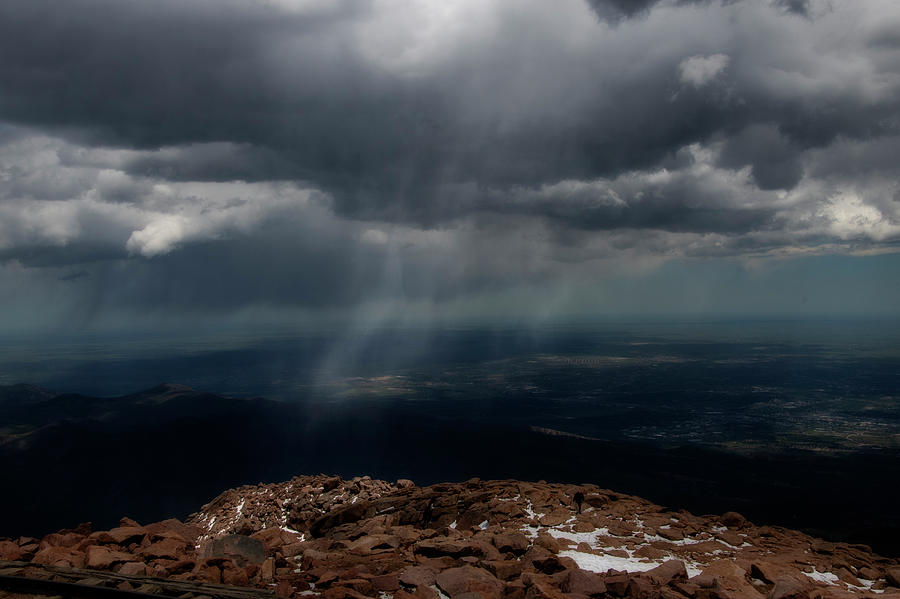 Rain falling in distance on mountain by Dan Friend