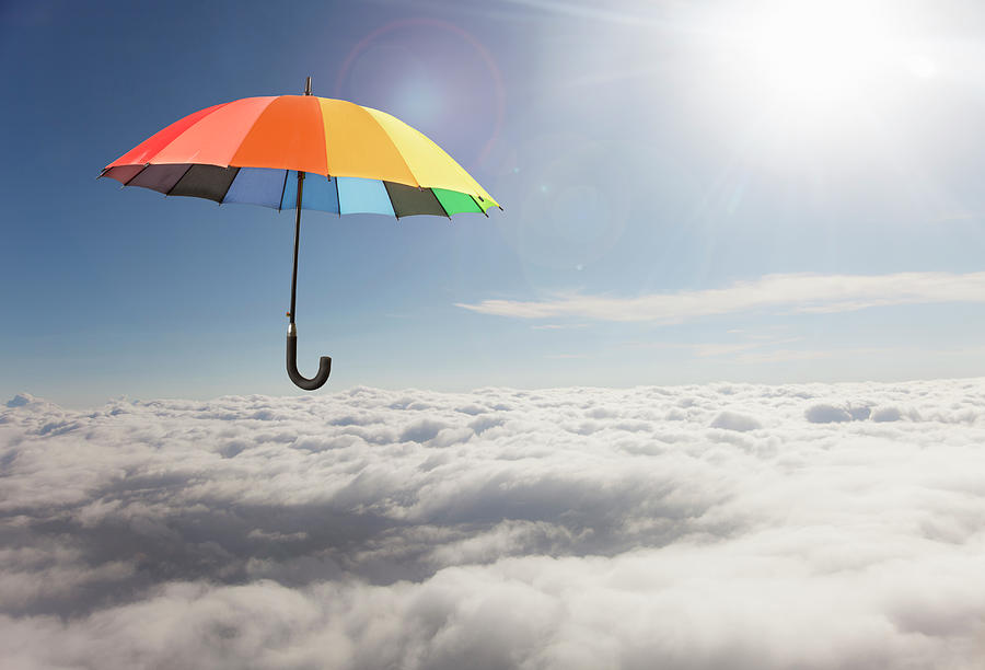 Rainbow Umbrella Floating Above Clouds Photograph by Gary S Chapman