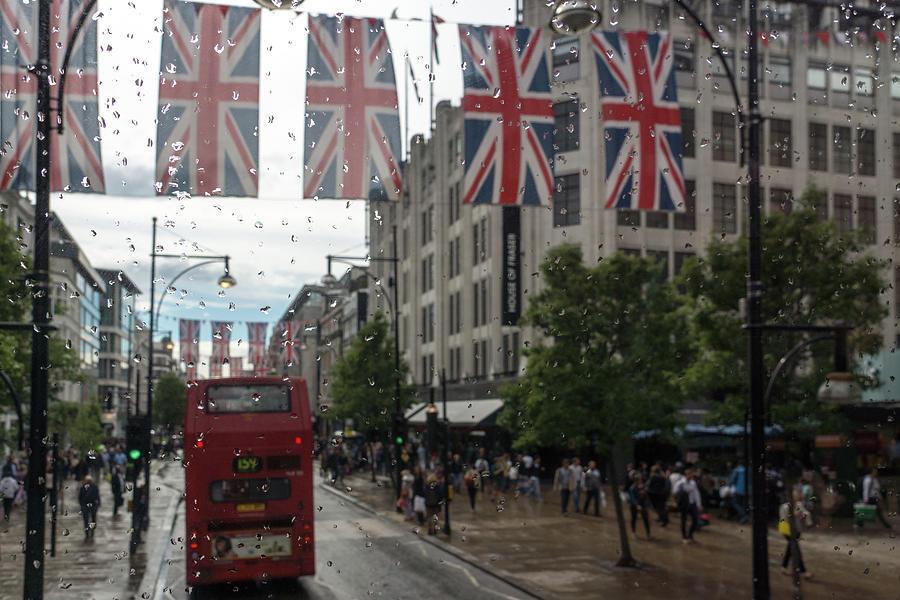 Rainy London - Oxford Street Red Double Decker Bus and Union Jacks by Georgia Mizuleva