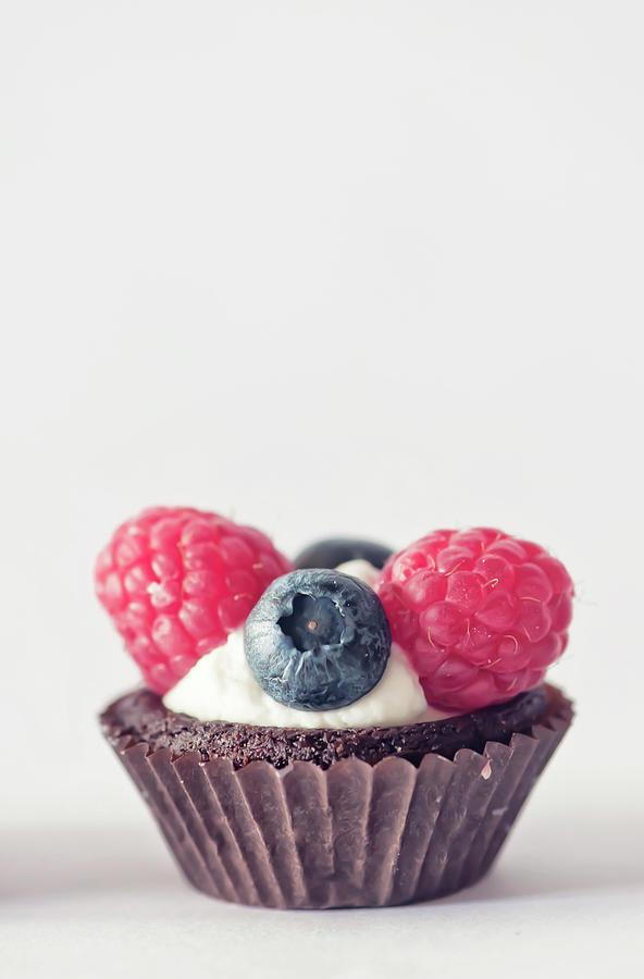 Raspberries And Blueberries Cupcake Photograph by Marta Nardini
