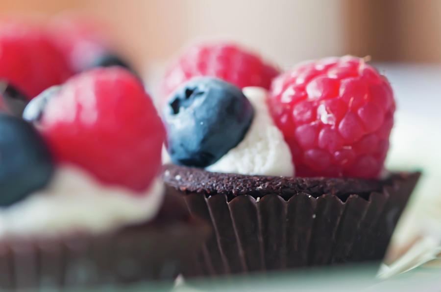 Raspberries And Blueberries Photograph by Marta Nardini