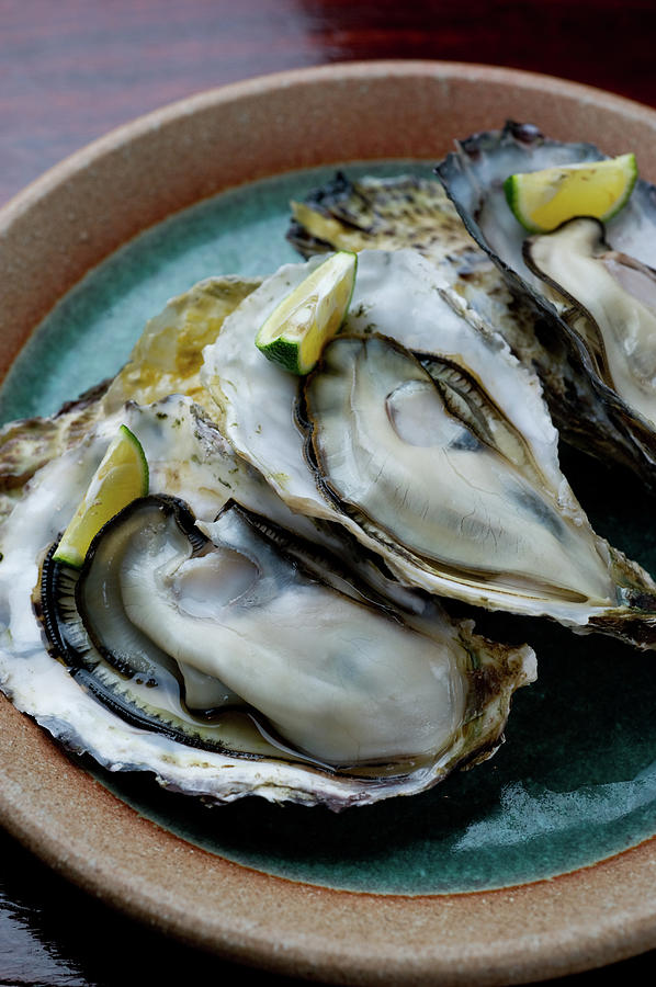 Raw Oyster Photograph by Ryouchin