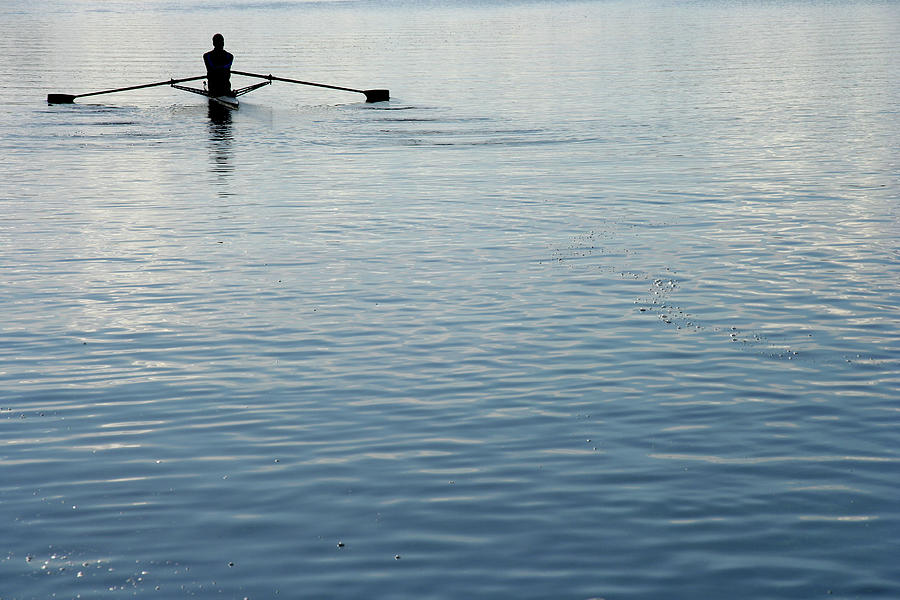 Rear View Of A Man Rowing A Boat Photograph by Ggwink
