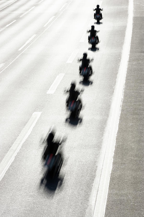 Rear View Of Row Of Motorcycle Riders Photograph by Jorg Greuel