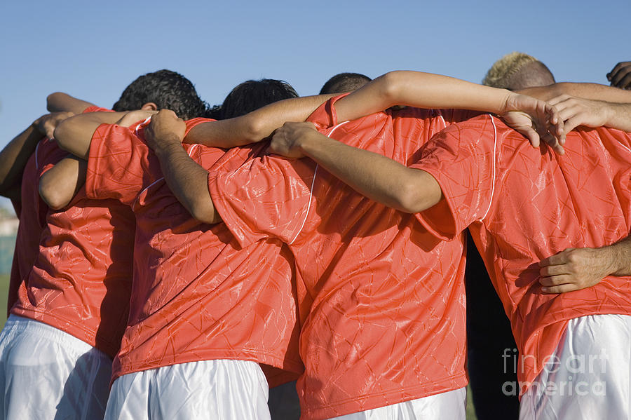 Friendship Photograph - Rear View Of Young Soccer Players by Sirtravelalot