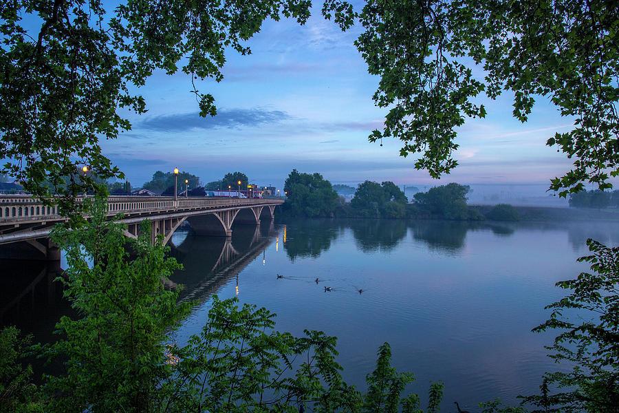 Receding fog on the river by Lynn Hopwood