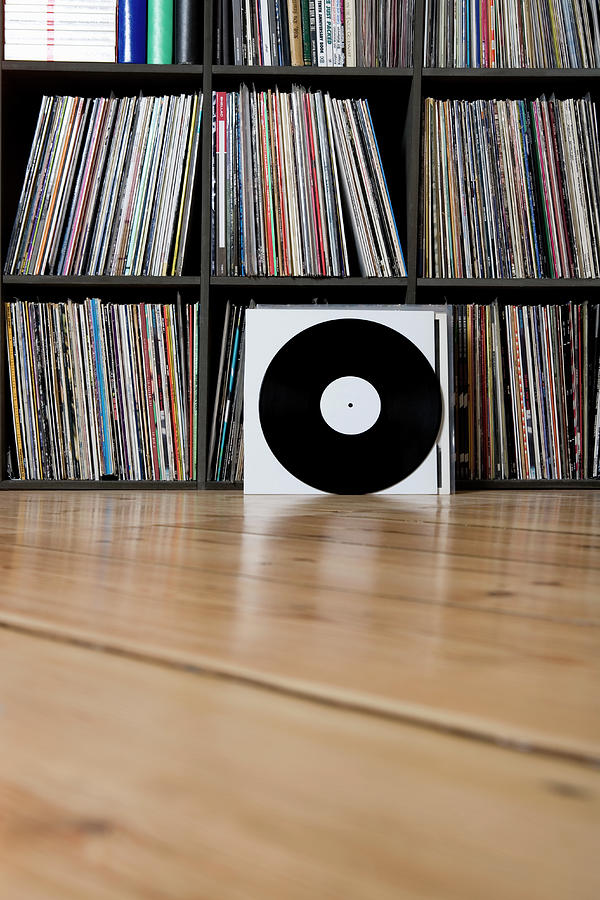 Records Leaning Against Shelves Photograph by Halfdark