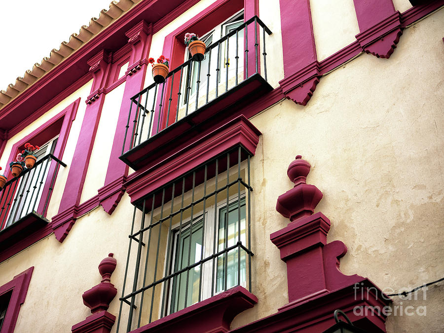 Red Accent in Seville by John Rizzuto