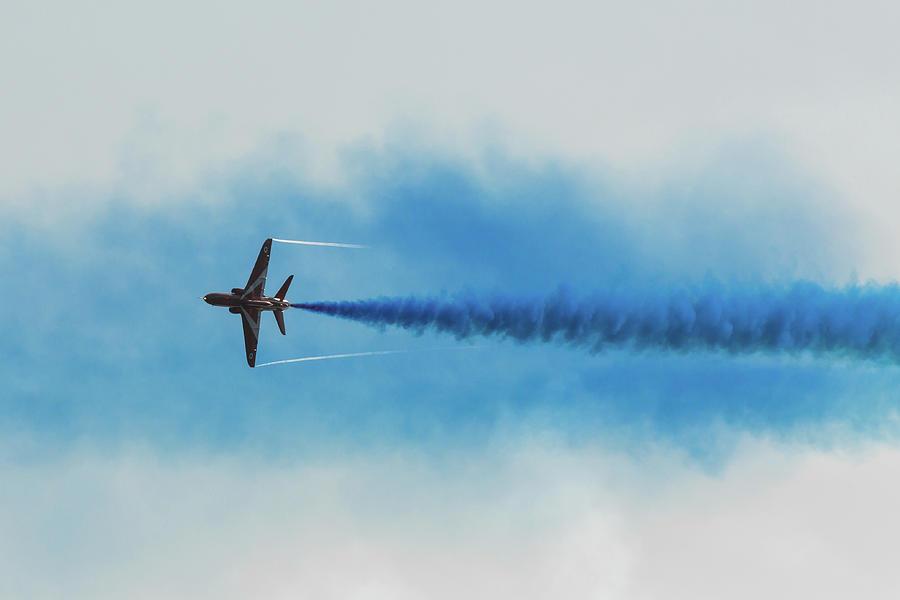 Red Arrow Blue Smoke Photograph