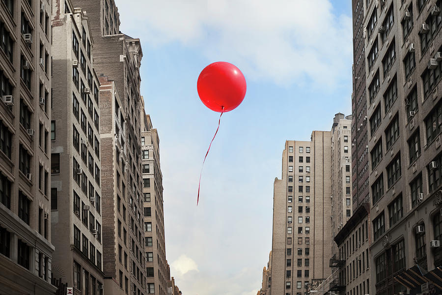 Red Balloon Floating Through City Photograph by Thomas Jackson