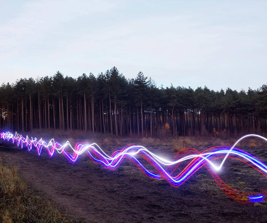Red, Blue And White Light Trails On Photograph by Tim Robberts