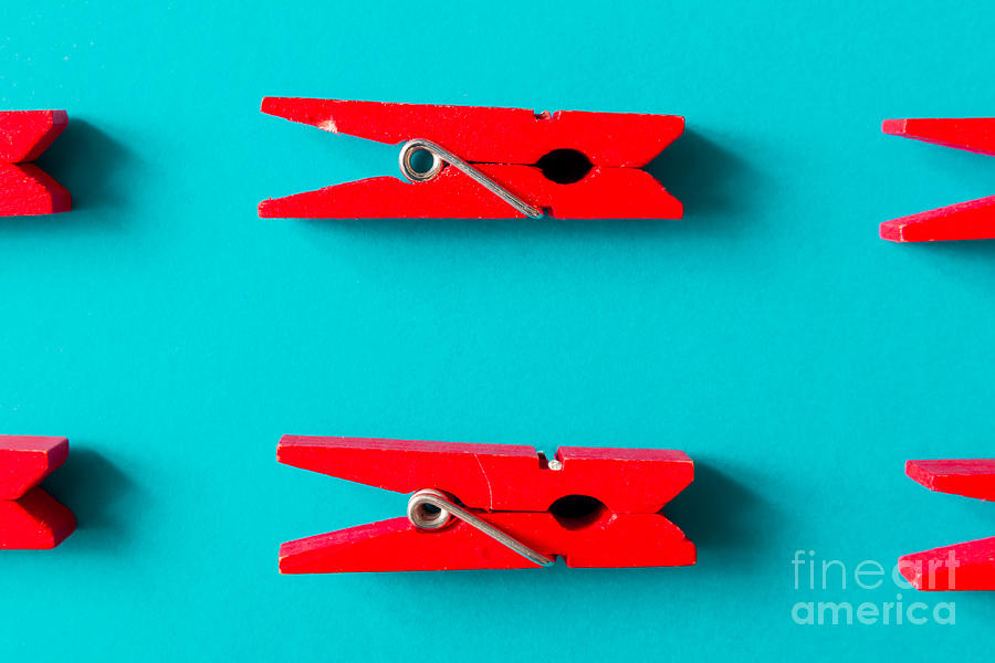 Color Photograph - Red Clothespins On Cyan Background by Zamurovic Photography