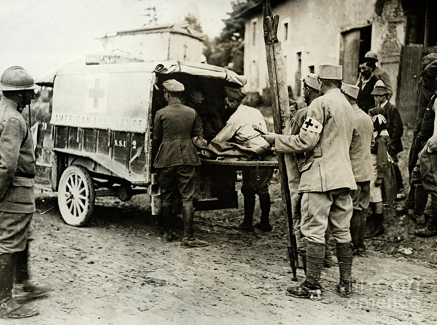 Red Cross Moving Wounded Soldiers Photograph by Bettmann