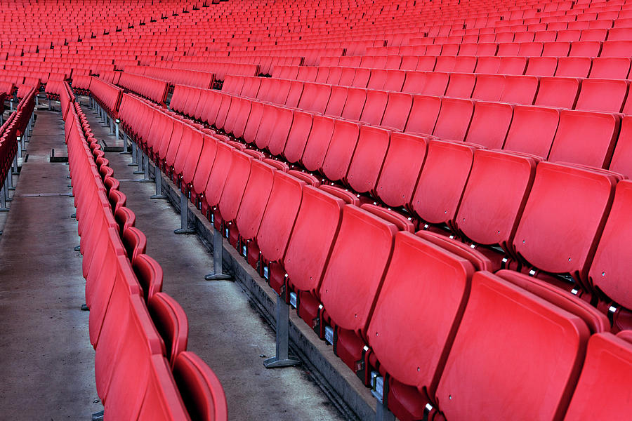 Red Empty Chairs In A Stadium Photograph by Jonathan Kitchen