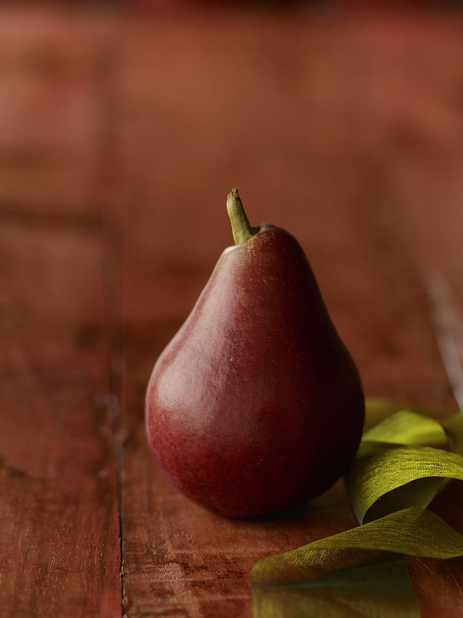 Red Pear With Green Ribbon Photograph by Carin Krasner