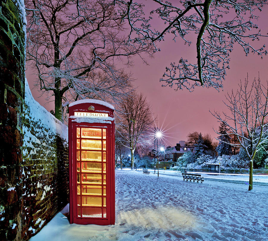 Red Phone Box Covered In Snow Photograph by Photo By John Quintero