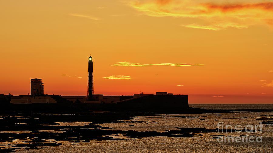 Red Sky at Dusk Saint Sebastian Castle and Lighthouse by Pablo Avanzini