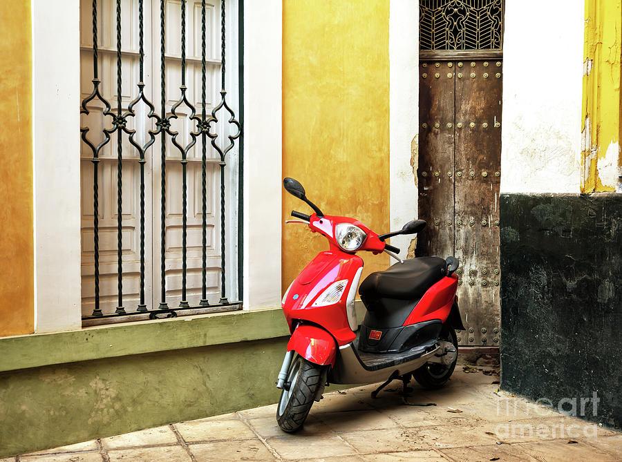 Red Vespa in Seville by John Rizzuto
