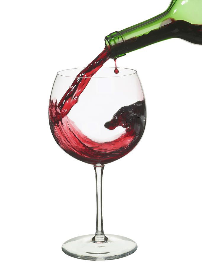 Red Wine Pouring From A Bottle Photograph by Ralphbaleno