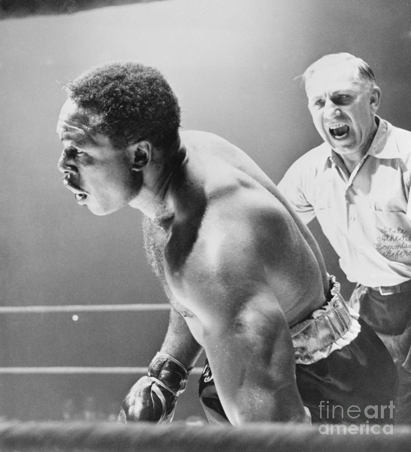Referee Counting As Boxer Archie Moore Photograph by Bettmann