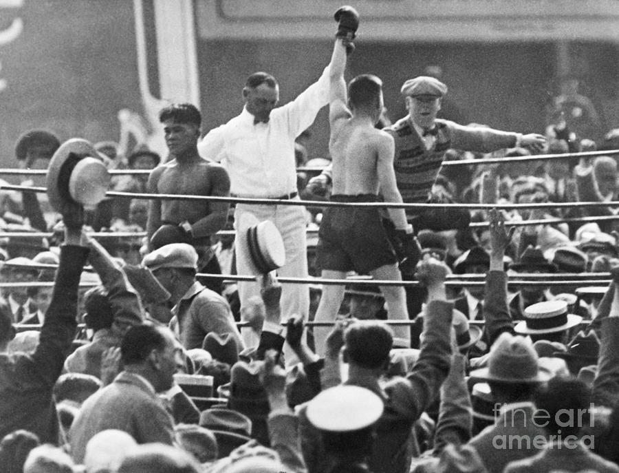 Referee Holds Boxers Hand In Victory Photograph by Bettmann
