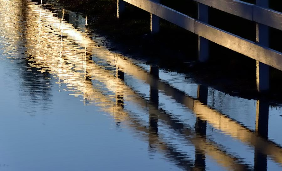 Reflected Fence At Sunrise by Jerry Sodorff