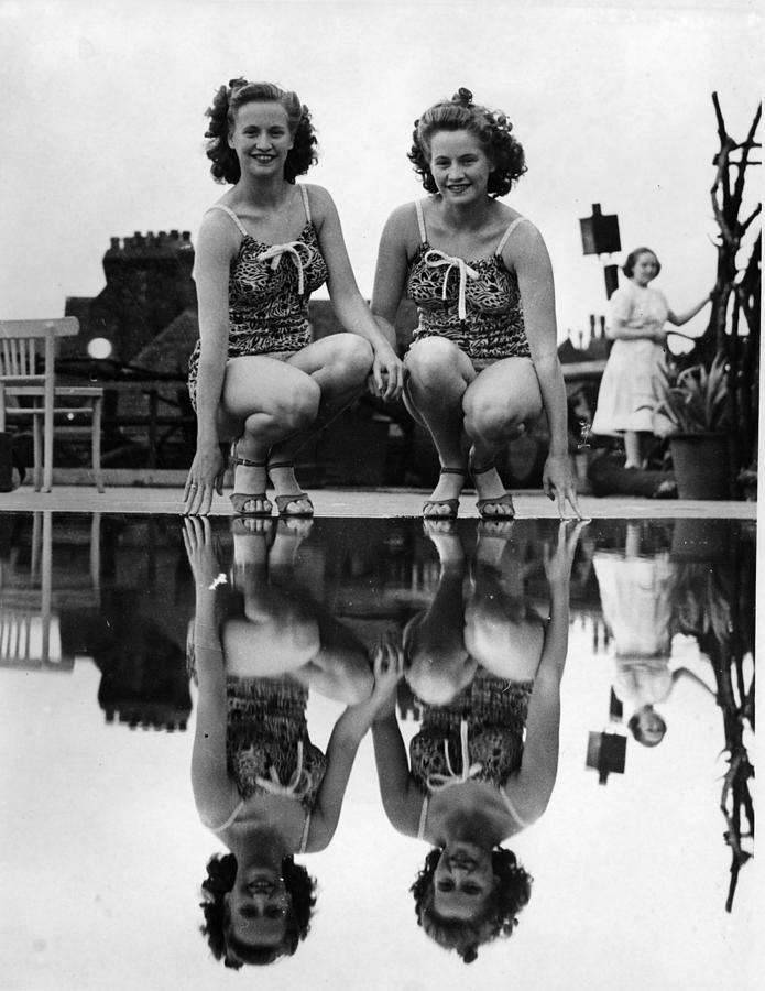 Reflected Twins Photograph by Fox Photos