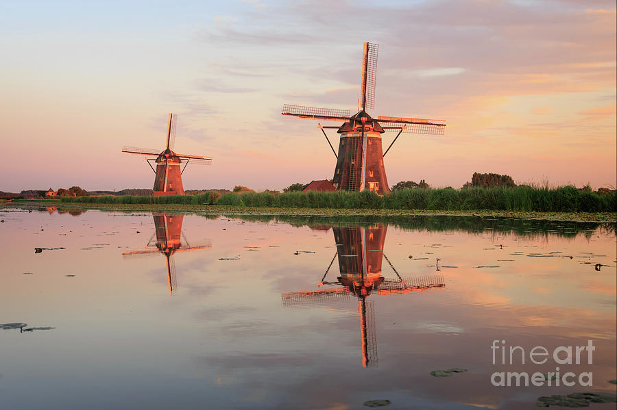 Windmills Photograph - Reflection Of Two Traditional Windmills In The Water At Sunset  by IPics Photography