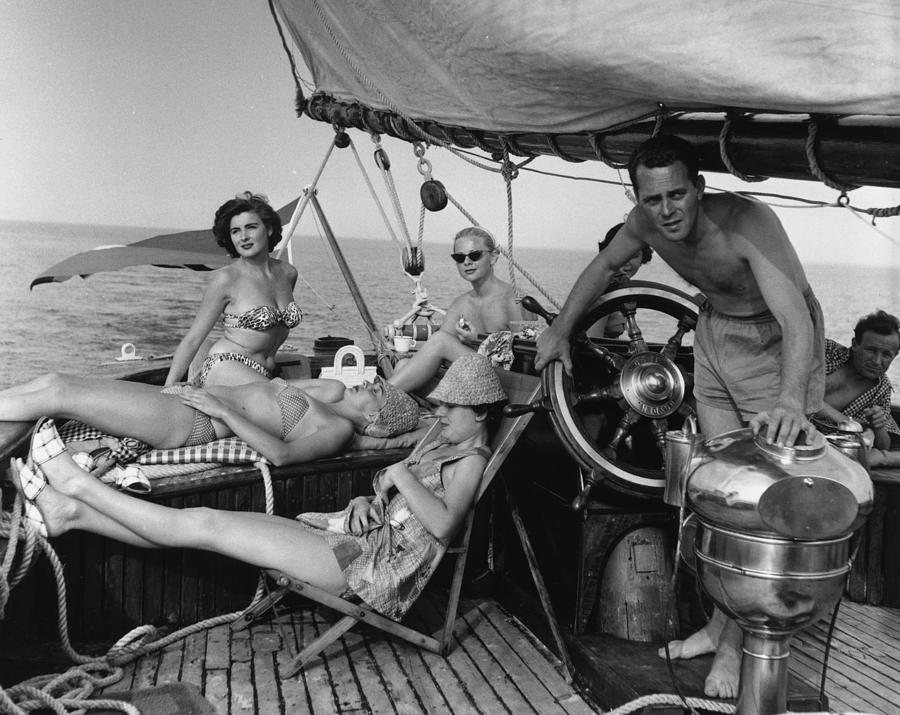 Relaxing On Yacht Photograph by Bert Hardy