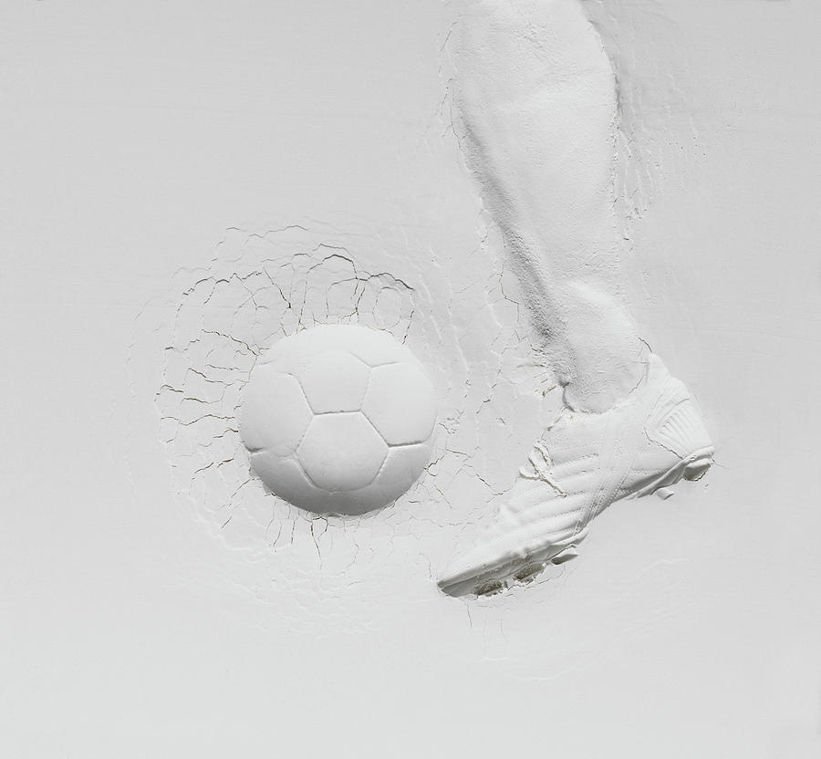 Relief Of Football Player Photograph by Henrik Sorensen