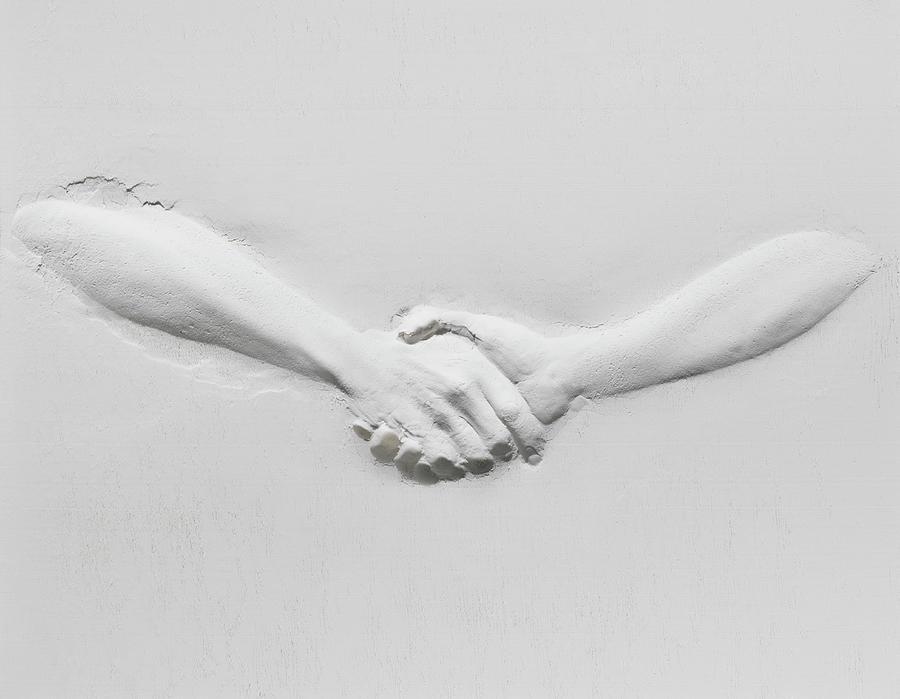 Relief Of Handshake Photograph by Henrik Sorensen