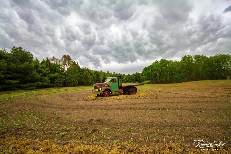 REO Farm Truck Stormy Sky by Robert Seifert