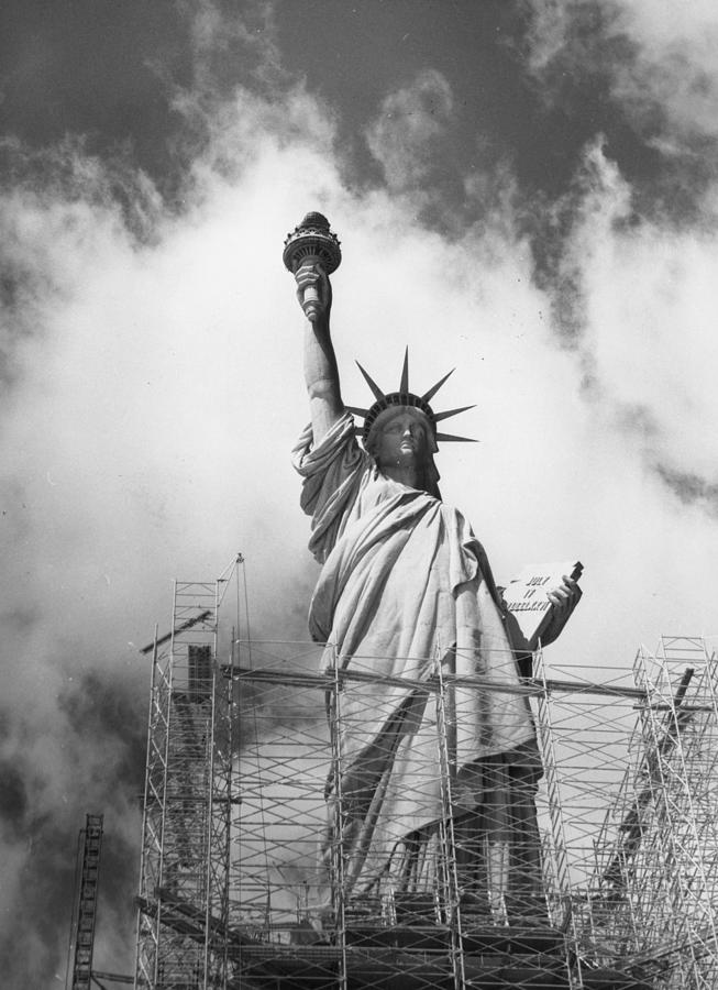 Repairing Liberty Photograph by Peter Keegan