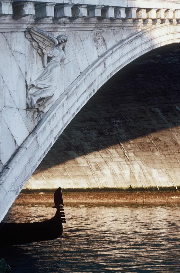 Rialto Bridge And Gondola Photograph by Jorg Greuel